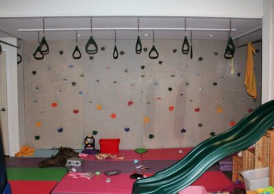 Jungle gym in the basement to work off extra energy